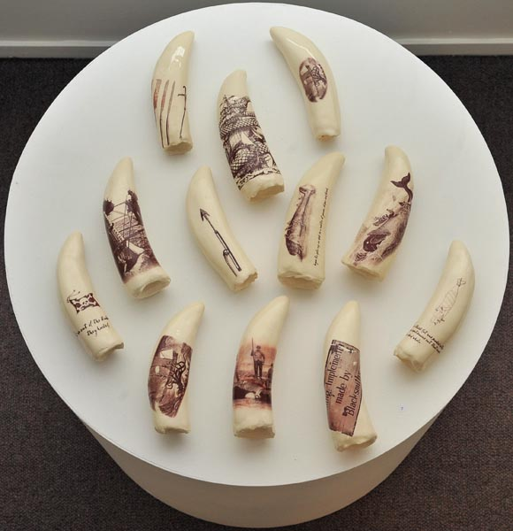 Phillipa Durkin, Whales' teeth, from Ceramics & works on paper - installation photo, scrimshaw, ceramics with decals